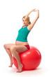 Beautiful pregnant woman using gym ball