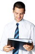 Portrait of happy smiling businessman with folder, isolated