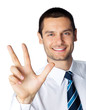 Portrait of smiling businessman showing three fingers, isolated