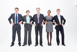 Five businesspeople standing arm in arm