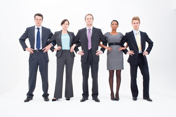 Five serious businesspeople standing arm in arm