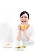 beautiful asian woman eating breakfast