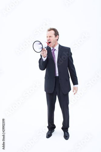 Businessman shouting into megaphone