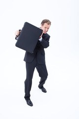 Businessman defending himself with briefcase