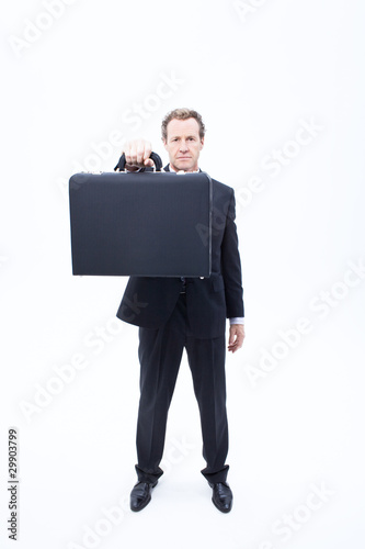 Serious businessman holding briefcase