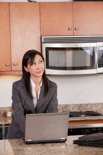 Attractive twenties vietnamese woman working from home