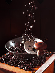 Close-up of an old-fashioned coffee grinder with coffee beans