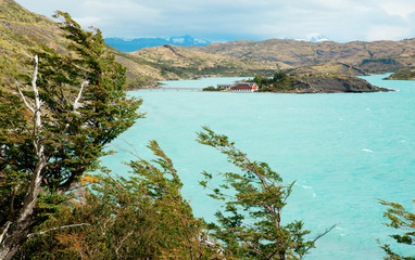 Scenic view of Pehoe lake and Pehoe hostel in Torres del Paine n