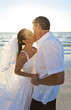 Bride & Groom Married Couple Kissing at Sunset Beach Wedding