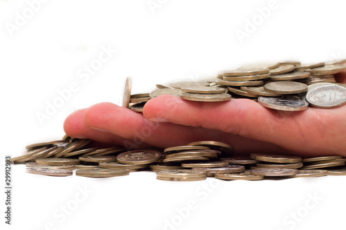 Hand filled up by coins on a white background