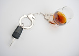 Car key locked to glass of alcohol poster