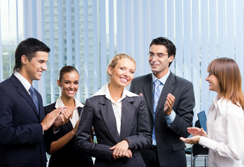 Successful happy businesswoman and businessteam at office