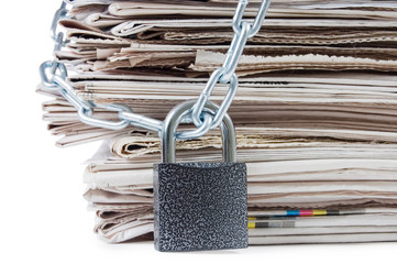 pile of newspapers with chains, on white