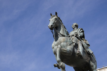 Madrid - Statue of Carlos III against blue sky, Puerta del Sol