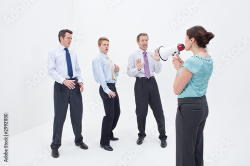 Female manager talking to businessmen with megaphone