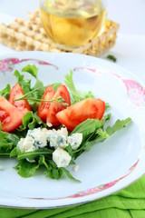 Salad with tomatoes and blue cheese with lettuce