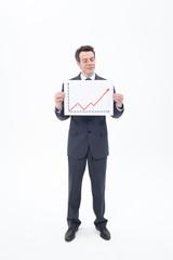 Businessman holding ascending line chart
