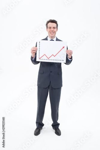 Smiling businessman holding ascending line chart