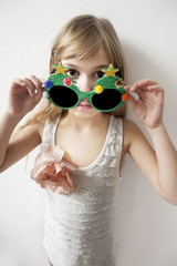 Little girl wearing big round glasses
