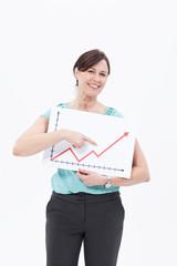 Smiling businesswoman holding ascending line chart