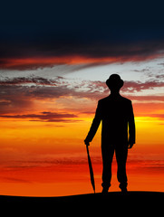 businessman standing in sunset