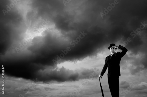Stormy sky and businessman