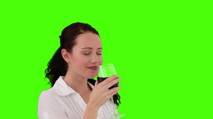 Brunette enjoying a glass of red wine
