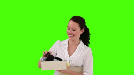 Brunette woman opening a gift