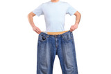 Weight loss male showing his old jeans