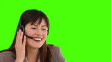 Businesswoman with an headset talking