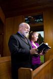 Senior Man Young Woman Church Singing Hymnals poster