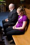 Senior White Man Young Woman Praying in Church Pew poster