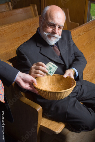 Senior Man Putting Money into Church Basket