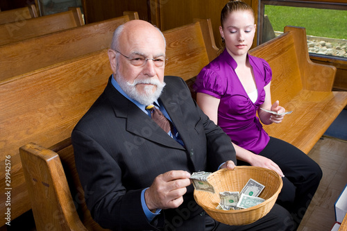 Senior Man Young Woman Putting Money Church Basket