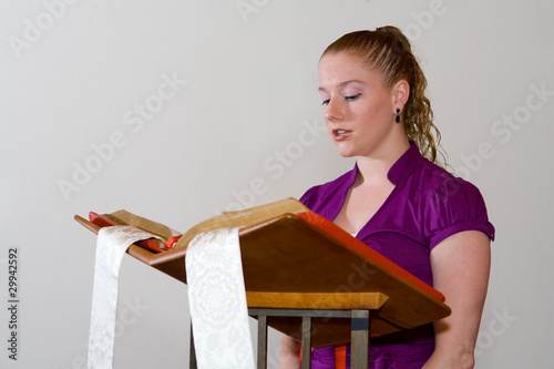 Leinwanddruck Bild Young Caucasian Woman Reading Bible Church Pulpit