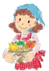 野菜のかごを抱える女性