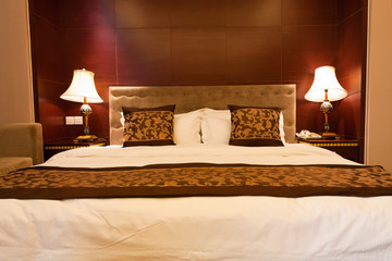Hotel bedroom with kingsized bed and lamps