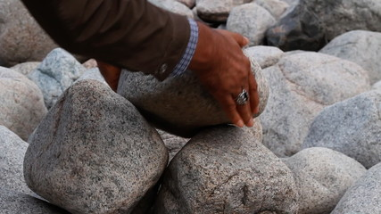 Hands with a rock.