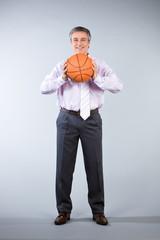 Coach holding a ball