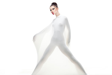 a conceptual studio shot of a young woman dressed in white.