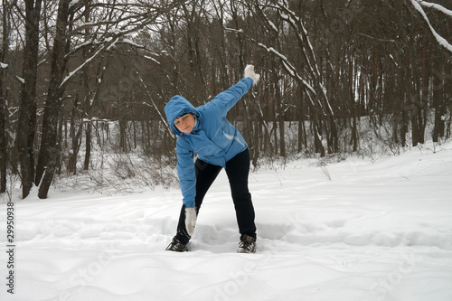 woman carries forward the slopes