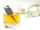A car key in a glass of whisky