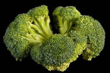 broccoli heads across black