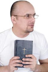 The man reads the bible
