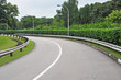 Curving Road Going Uphill With Crash Barriers