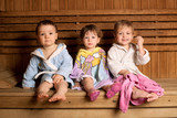Fototapety three funny children sitting in sauna