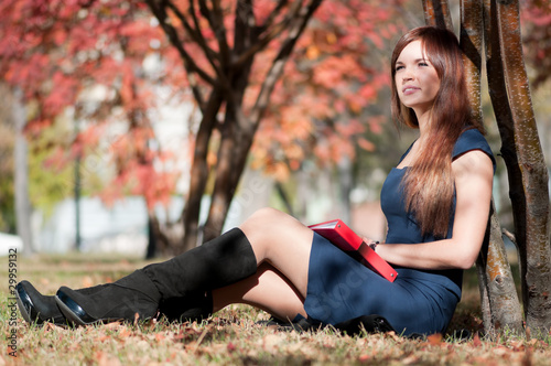 business woman reviewing diary at city park