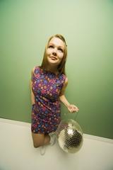 Woman Holding A Disco Ball