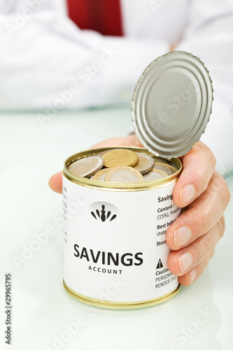 Senior businessman hands holding can with coins