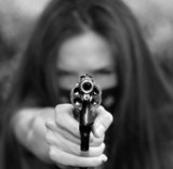 Woman points Gun